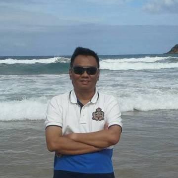 Putu Tantra, 51, Batam, Indonesia