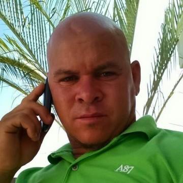 Carlos Restituyo, 44, Santiago, Dominican Republic