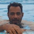 yu, 43, Tripoli, Libya