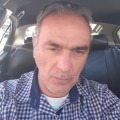 Dion K, 50, Athens, Greece