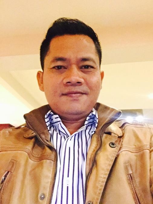 Iputu Darmaya, 43, Denpasar, Indonesia